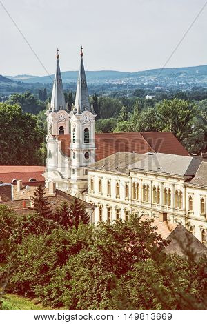 Saint Ignatius church view from Esztergom basilica Hungary. Travel destination. Cultural heritage. Urban scene. Beauty photo filter. Religious architecture.