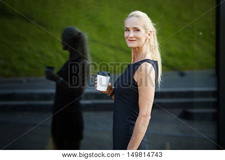 Content Businesswoman Holding Cup Of Coffee