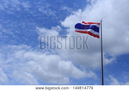 Thailand flag with blue sky and white cloud