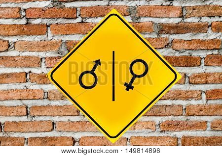 Toilet sign on brick wall or brown background