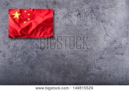 China flag. Peoples Republic of China flag on concrete background.