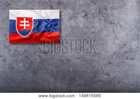 Flags of the Slovak Republic on concrete background.