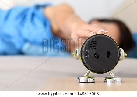 Woman Stretching Out To Shut Down The Alarm