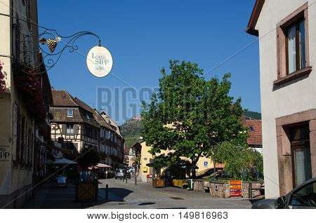 RIBEAUVILLE, FRANCE - SEPTEMBER 13: View from the main street Grand Rue in the old village Ribeauville in Alsace in France located by the Alsace wine route on September 13, 2016.