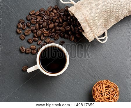 A cup of coffee with coffe beans as background