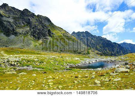 Mountain landscape in the Western Carpathians. Small lake in Mengusovska Valley, Vysoke Tatry (High Tatras), Slovakia