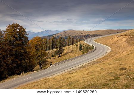 Landscape of a mountain road in autumn