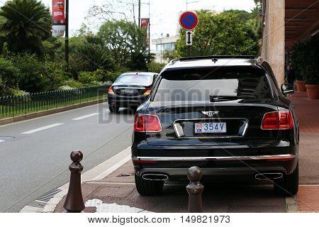 Monte-Carlo Monaco - May 18 2016: Black Bentley Bentayga Luxury SUV (Rear View) At The City Street in Monaco French Riviera