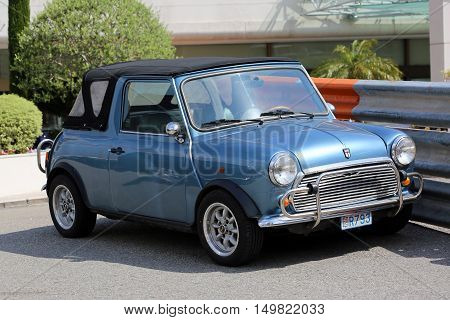 Monte-Carlo Monaco - May 18 2016: Blue Retro Car Austin Mini Cooper (Side View) At The City Street in Monaco French Riviera