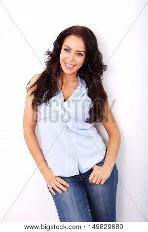 Smiling Woman Standing Against White Background