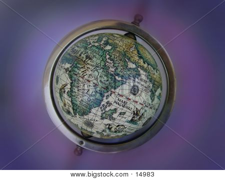 an old toy globe with symbolic ancient map. blurred background. poster