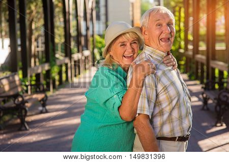 Senior woman hugging man. Elderly couple is laughing. Trust and support. Live entire life together.