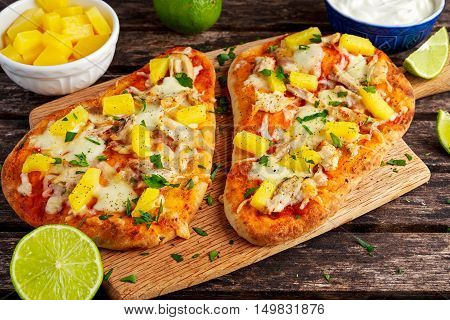 Homemade hawaii Flatbread Pizza with chicken and pineapple dressing yogurt sauce