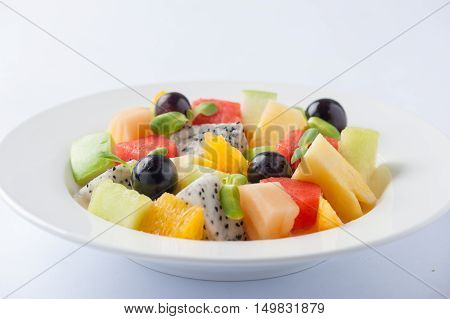 Modern cuisine style fruits salad in ceramic dish