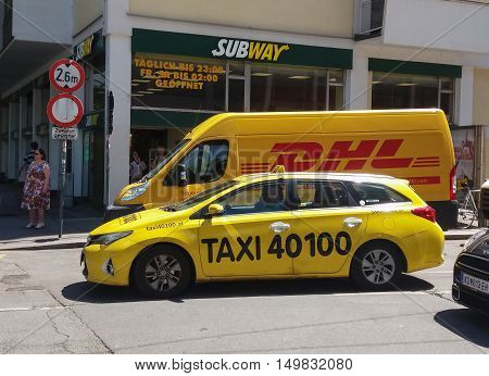 Dhl Van And Taxi On The Street