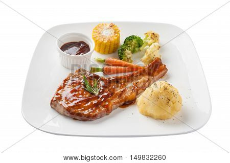 Front view of Modern style pork chop with barbecue sauce mashed potatoes grilled vegetables in ceramic dish isolated on white background