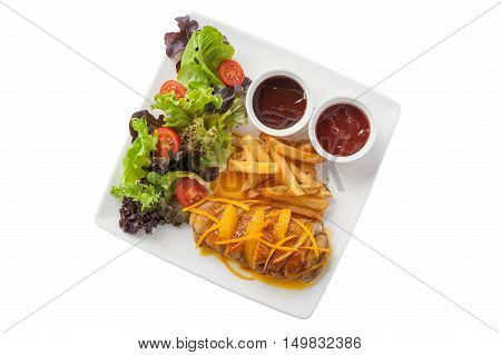 Top view of Modern cuisine style roasted duck breast dressed with orange sauce including french fries vegetables and sauces in ceramic dish isolated on white background