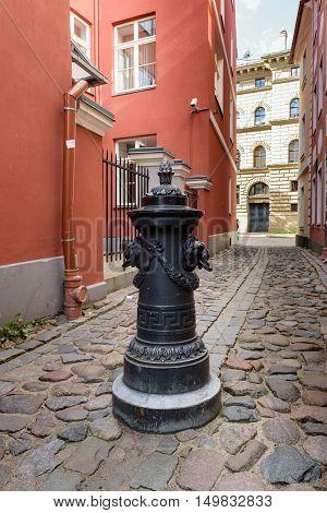 Traditional narrow street in old town of Riga city, Latvia