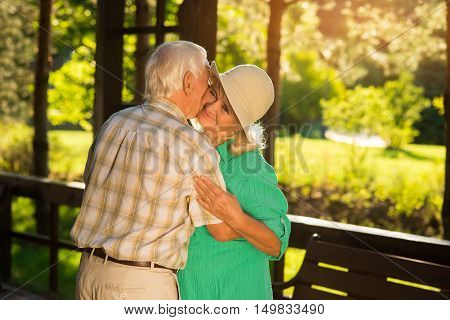 Elderly couple is hugging. Smile of senior woman. Thanks for all the years. My one and only.