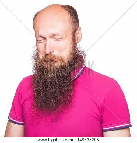 Portrait of a sad bald bearded man crying isolated on white background.