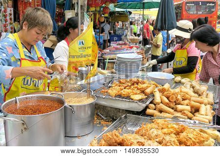 CHINATOWN, BANGKOK,THAILAND-SEPTEMBER 25, 2016:street food at Yaowarat Road. Yaowarat road is various products such as street food, gold shop.Restaurant., Famous and Popular destinations for tourists.