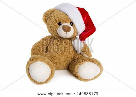 Teddy bear with Santa Claus hat isolated on a white background