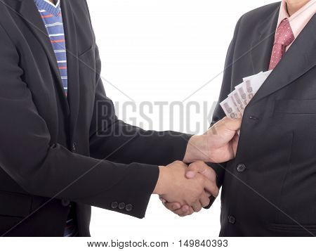 Businessman giving a bribe to the pocket for corruption something on isolated / white background