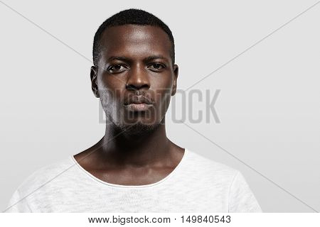 Headshot Of Attractive Serious African Student With Small Beard And Moustache, Dressed In Casual T-s