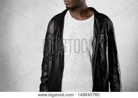 Advertising Concept. Cropped Picture Of Fashionable African Man Wearing Stylish Leather Jacket And W