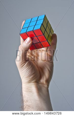 TURKEY - ISTANBUL - April 22 , 2010: Hand and Rubik's cube puzzle