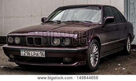 Kazakhstan, Ust-Kamenogorsk, october 2 , 2016: BMW 525, old car, old german vehicle in the street, old BMW, bmw e34 5-series, sedan, dark burgundy