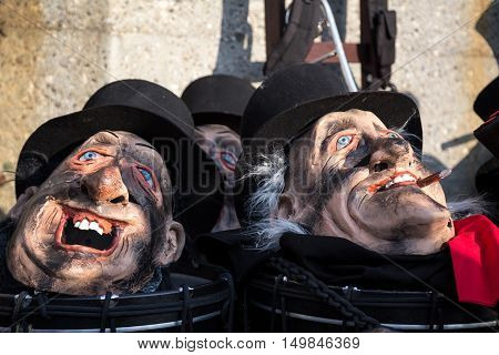Basel, Switzerland - March 10, 2014: Masks lying around at the tradtional carnival parade