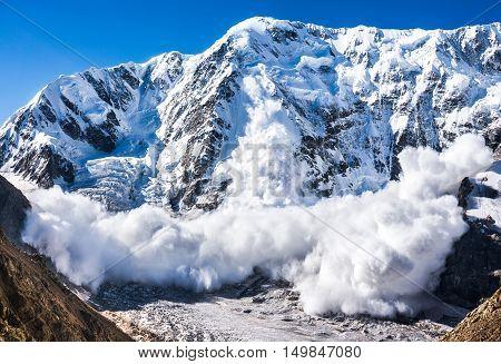 Power of nature. Real huge avalanche comes from a big mountain Shkhara 5.193 m Caucasus Kabardino-Balkaria Bezengi region Russia