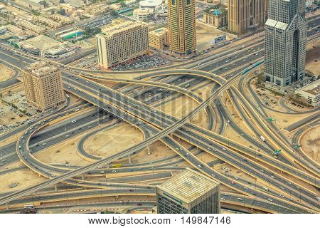 Aerial view of traffic on Sheikh Zayed Road highway interchange in Dubai downtown from the top in United Arab Emirates.