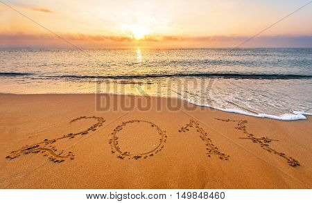 New Year 2017 is coming concept. Happy New Year 2017 replace 2016 concept on the sea beach