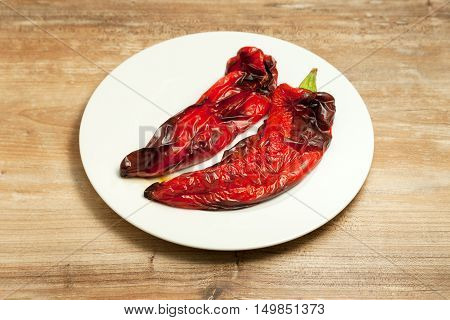 grilled vegetables peppers Eggplant on plate on wood background.