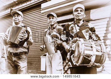 SANTO DOMINGO, DOMINICAN REPUBLIC - January 24, 2016: Merengueros in Calle el Conde, Colonial Zone. Toning Brown version of the shot.