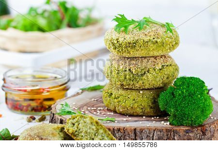 Healthy vegan burger with broccoli and spinach patty Healthy fast food on a cutting wooden board
