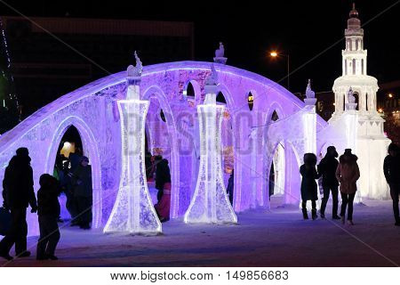 PERM RUSSIA - JAN 4 2016: People walk in illuminated Ice town Ice town in Perm - traditional winter attraction
