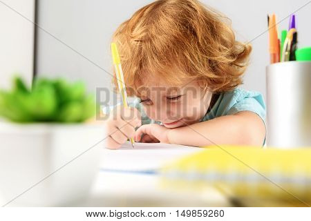 childhood and learning concept, selective focus on happy child studying in kindergarten