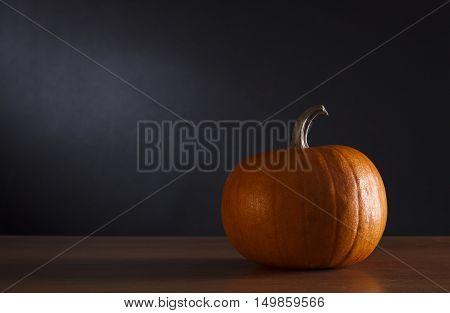 Happy Halloween pumpkinon a dark background .