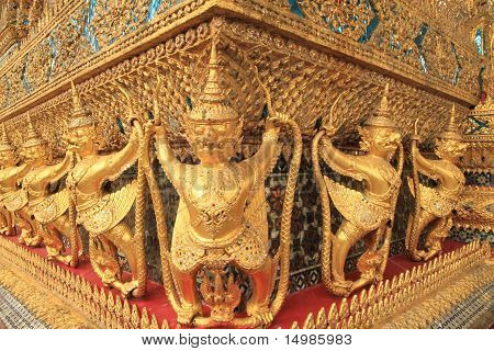 Gold ornamental patter statuettes at The Grand palace in Bangkok.