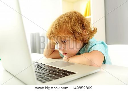 learning and next generation concept, bored kid using laptop