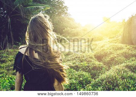 Young woman staring at the sunset on Seychelles