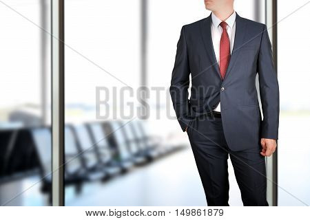 business and office concept - elegant young fashion buisness man in a blue/navy suit