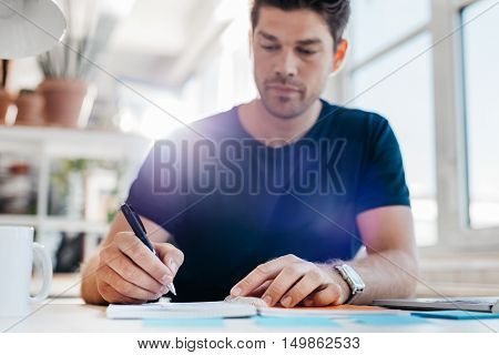 Young Businessman Updating His Personal Organizer