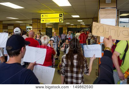 Simferopol, Russia - June 15, 2016: Our people expect the arriving passengers at the exit of the arrivals zone Simferopol airport