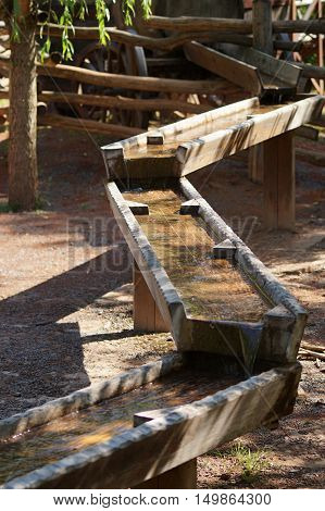 Historical wooden sluice at finding for gold