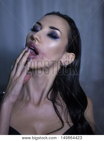 Sexy Emotional Beautiful Woman Rubbing Lipstick. Passionate lover Seductress. Passion Smeared lipstick. Temptress. Beauty Face with sloppy makeup Sexy Sensual fatal Girl. Provocative crazy look