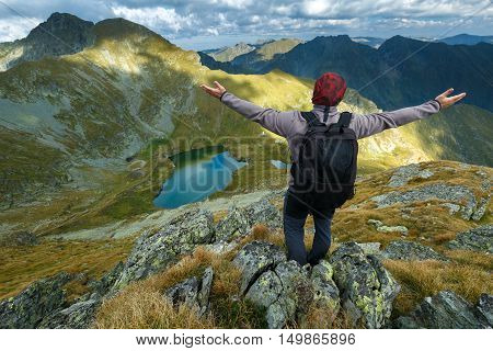 Hiker With Backpack On Mountains